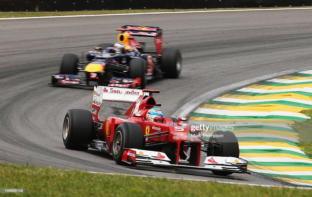 Fernando Alonso of Spain and Ferrari drives ahead of <a gi-track='captionPersonalityLinkClicked' href=/galleries/search?phrase=Sebastian+Vettel&family=editorial&specificpeople=2233605 ng-click='$event.stopPropagation()'>Sebastian Vettel</a> of Germany and Red Bull Racing during the final practice session prior to qualifying for the Brazilian Formula One Grand Prix at the Autodromo Jose Carlos Pace on November 24, 2012 in Sao Paulo, Brazil.