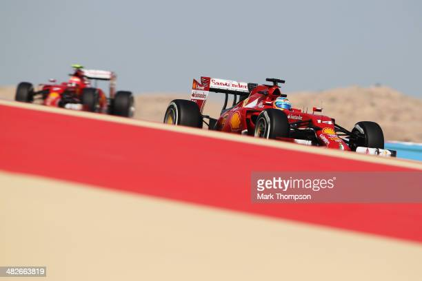 Fernando Alonso of Spain and Ferrari drives ahead of team mate Kimi Raikkonen of Finland and Ferrari during practice for the Bahrain Formula One...