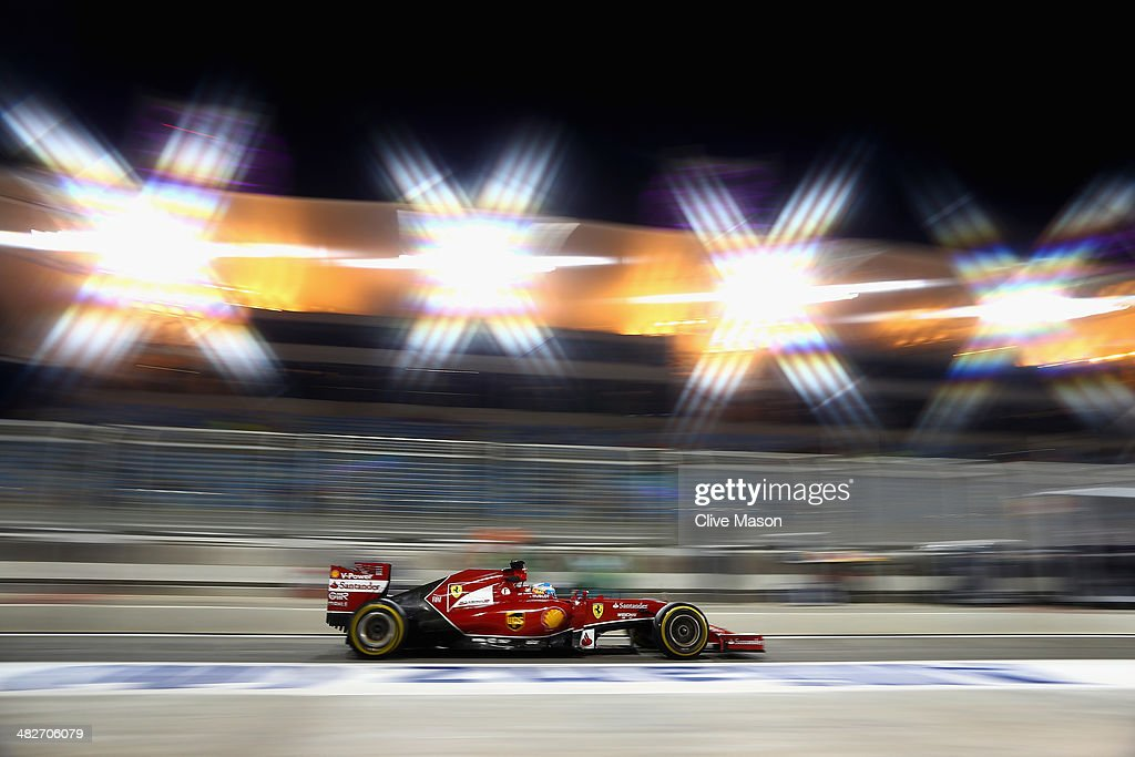 Fernando Alonso of Spain and Ferrari drives down the pitlane during practice for the Bahrain Formula One Grand Prix at the Bahrain International...