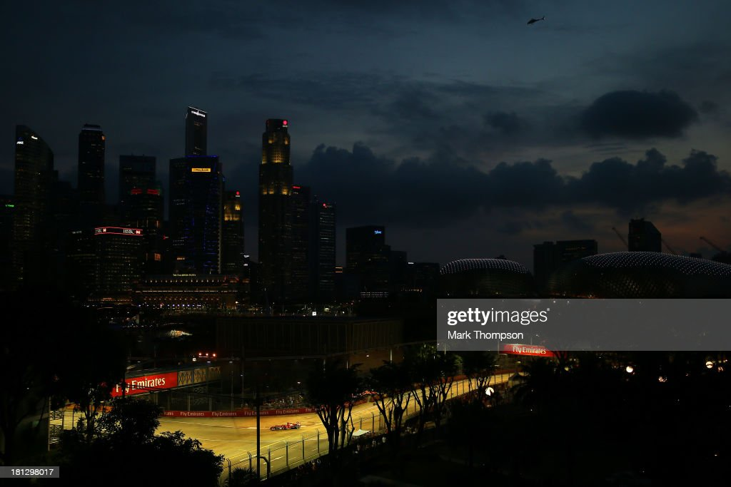 Fernando Alonso of Spain and Ferrari drives during practice for the Singapore Formula One Grand Prix at Marina Bay Street Circuit on September 20, 2013 in Singapore, Singapore.