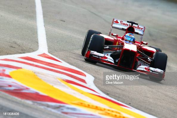 Fernando Alonso of Spain and Ferrari drives during practice for the Singapore Formula One Grand Prix at Marina Bay Street Circuit on September 20...