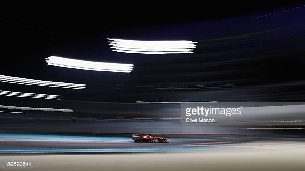 Fernando Alonso of Spain and Ferrari drives during practice for the Abu Dhabi Formula One Grand Prix at the Yas Marina Circuit on November 1 2013 in...