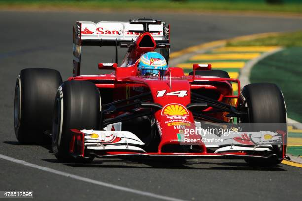 Fernando Alonso of Spain and Ferrari drives during practice for the Australian Formula One Grand Prix at Albert Park on March 14 2014 in Melbourne...
