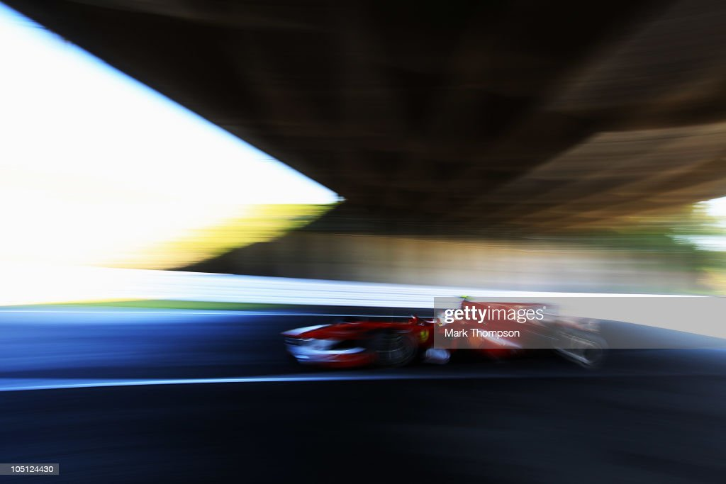 Fernando Alonso of Spain and Ferrari drives during qualifying for the Japanese Formula One Grand Prix at Suzuka Circuit on October 10, 2010 in Suzuka, Japan.