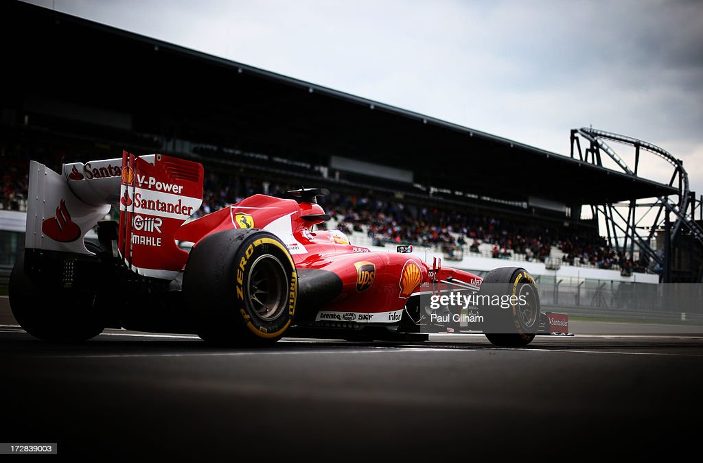 Fernando Alonso of Spain and Ferrari drives into the pitlane during practice for the German Grand Prix at the Nuerburgring on July 5, 2013 in Nuerburg, Germany.