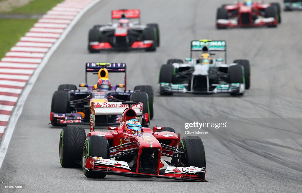 Fernando Alonso of Spain and Ferrari drives with a broken front wing during the Malaysian Formula One Grand Prix at the Sepang Circuit on March 24, 2013 in Kuala Lumpur, Malaysia.