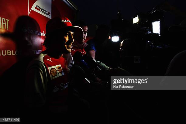 Fernando Alonso of Spain and Ferrari is interviewed by the media following day two of Formula One Winter Testing at the Bahrain International Circuit...