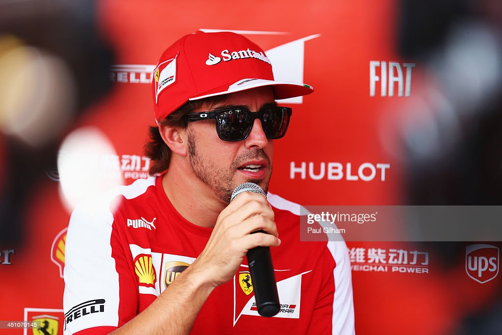 Fernando Alonso of Spain and Ferrari is interviewed by the media during previews for the Brazilian Formula One Grand Prix at Autodromo Jose Carlos Pace on November 21, 2013 in Sao Paulo, Brazil.