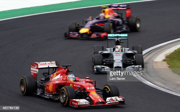 Fernando Alonso of Spain and Ferrari Lewis Hamilton of Great Britain and Mercedes GP and Daniel Ricciardo of Australia and Infiniti Red Bull Racing...