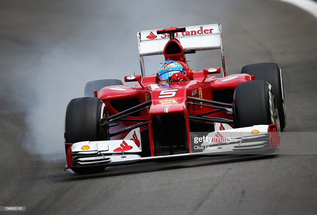Fernando Alonso of Spain and Ferrari locks his brakes as he drives during qualifying for the Brazilian Formula One Grand Prix at the Autodromo Jose Carlos Pace on November 24, 2012 in Sao Paulo, Brazil.