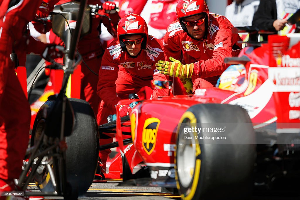 Fernando Alonso of Spain and Ferrari makes a pit stop during the Belgian Grand Prix at Circuit de Spa-Francorchamps on August 24, 2014 in Spa, Belgium.