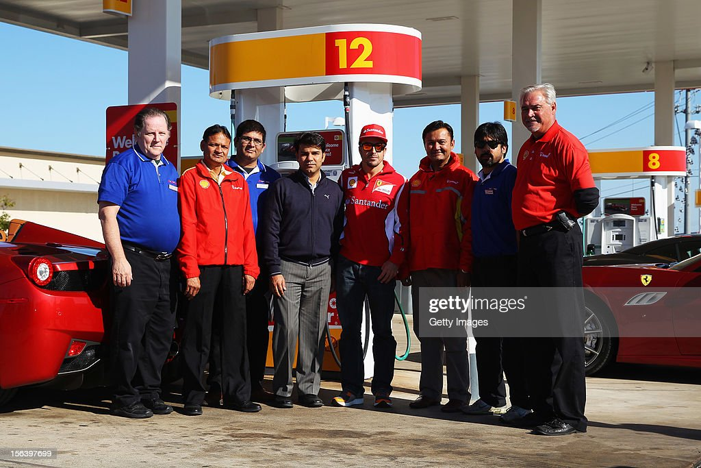 Fernando Alonso of Spain and Ferrari meets members of the media while attending an event held at a Shell filling station on November 14, 2012 in Austin, United States of America.