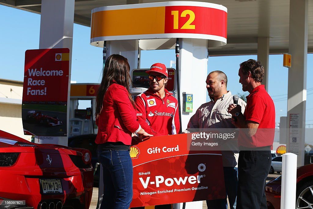 Fernando Alonso of Spain and Ferrari meets prize winners while attending an event held at a Shell filling station on November 14, 2012 in Austin, United States of America.