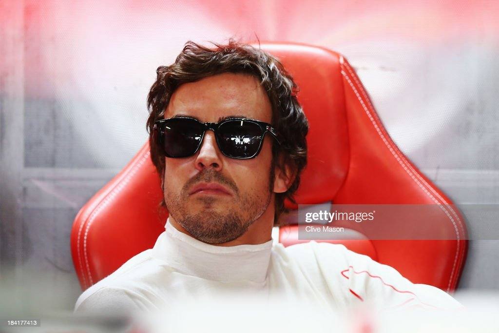 Fernando Alonso of Spain and Ferrari prepares to drive during the final practice session prior to qualifying for the Japanese Formula One Grand Prix...