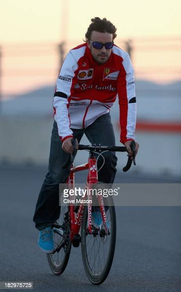 Fernando Alonso of Spain and Ferrari rides his bike round the track during previews for the Korean Formula One Grand Prix at Korea International...