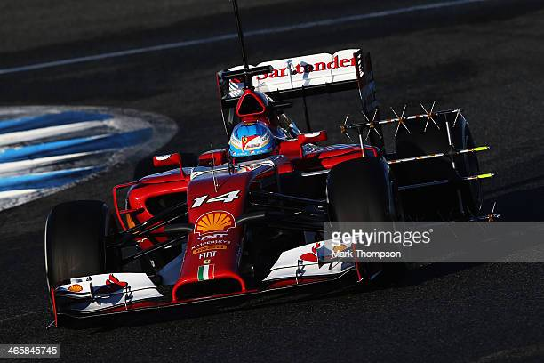 Fernando Alonso of Spain and Ferrari runs with sensors on the new F14T during day three of Formula One Winter Testing at the Circuito de Jerez on...