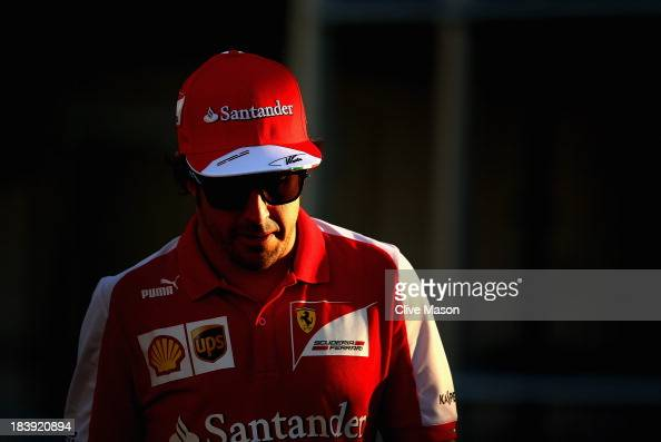 Fernando Alonso of Spain and Ferrari walks in the paddock during previews for the Japanese Formula One Grand Prix at Suzuka Circuit on October 10...