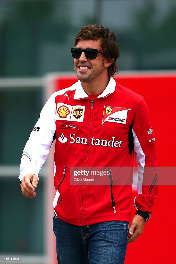 Fernando Alonso of Spain and Ferrari walks through the paddock ahead of the Chinese Formula One Grand Prix at the Shanghai International Circuit on April 17, 2014 in Shanghai, China.