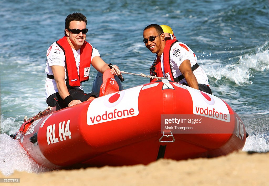 Fernando Alonso of Spain and Lewis Hamilton of Great Britain both of the McLaren Mercedes arrive on a inflatable life saving boat on St Kilda Beach...