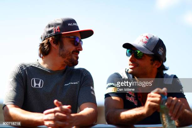 Fernando Alonso of Spain and McLaren Honda and Carlos Sainz of Spain and Scuderia Toro Rosso talk on the Drivers Parade before the Azerbaijan Formula...