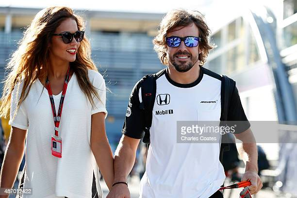 Fernando Alonso of Spain and McLaren Honda and his girlfriend Lara Alvarez walk in the paddock after qualifying for the Formula One Grand Prix of...