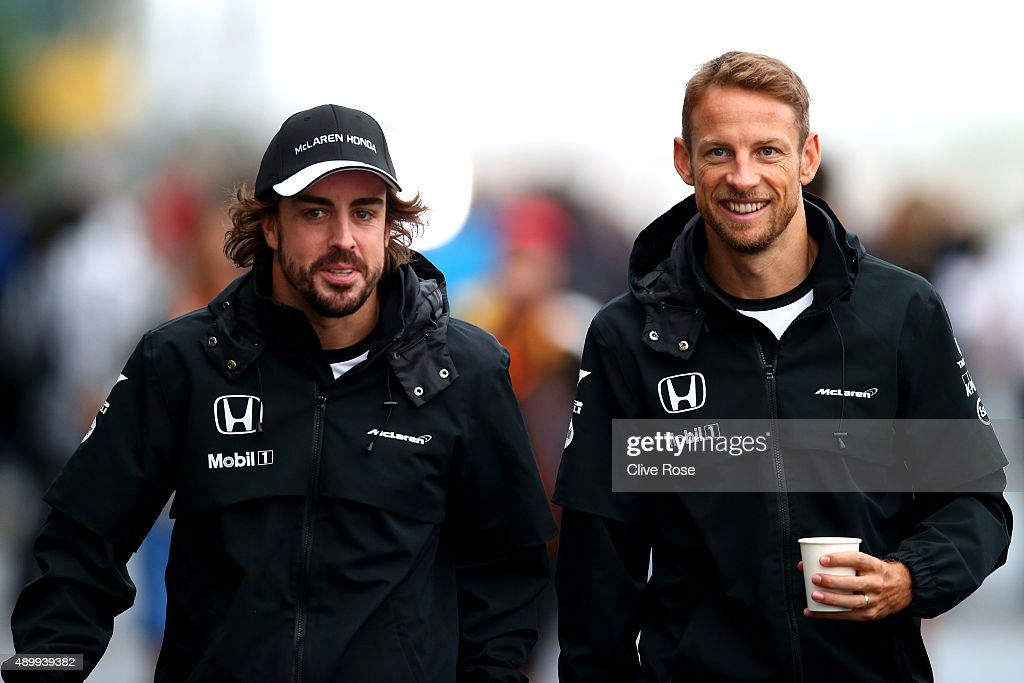 <a gi-track='captionPersonalityLinkClicked' href=/galleries/search?phrase=Fernando+Alonso+-+Race+Car+Driver&family=editorial&specificpeople=12323351 ng-click='$event.stopPropagation()'>Fernando Alonso</a> of Spain and McLaren Honda and <a gi-track='captionPersonalityLinkClicked' href=/galleries/search?phrase=Jenson+Button&family=editorial&specificpeople=171505 ng-click='$event.stopPropagation()'>Jenson Button</a> of Great Britain and McLaren Honda walk in the paddock during practice for the Formula One Grand Prix of Japan at Suzuka Circuit on September 25, 2015 in Suzuka.