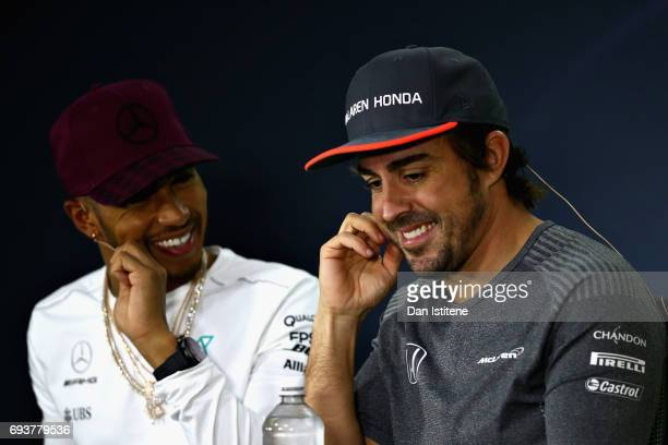 Fernando Alonso of Spain and McLaren Honda and Lewis Hamilton of Great Britain and Mercedes GP in the Drivers Press Conference during previews for...