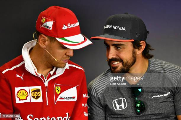 Fernando Alonso of Spain and McLaren Honda and Sebastian Vettel of Germany and Ferrari talk in the Drivers Press Conference during previews ahead of...