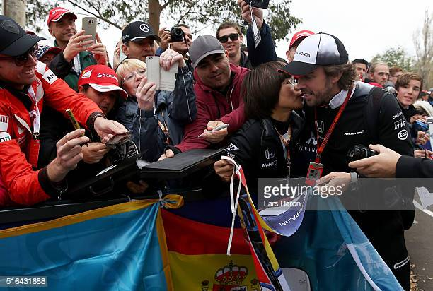 Fernando Alonso of Spain and McLaren Honda arrives at the circuit and gets a kiss from a fan during qualifying for the Australian Formula One Grand...