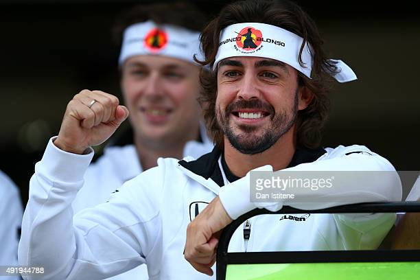 Fernando Alonso of Spain and McLaren Honda celebrates his 250th grand prix with his team including Jenson Button of Great Britain and McLaren Honda...