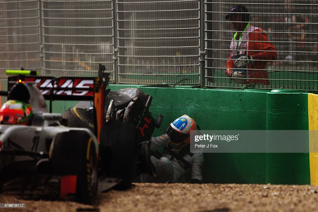 <a gi-track='captionPersonalityLinkClicked' href=/galleries/search?phrase=Fernando+Alonso+-+Race+Car+Driver&family=editorial&specificpeople=12323351 ng-click='$event.stopPropagation()'>Fernando Alonso</a> of Spain and McLaren Honda climbs out of his car after crashing Esteban Gutierrez of Mexico,(21) Haas F1 Team Haas-Ferrari VF-16 Ferrari 059/5 turbo during the Australian Formula One Grand Prix at Albert Park on March 20, 2016 in Melbourne, Australia.