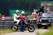 Fernando Alonso of Spain and McLaren Honda gets a lift back to the paddock after crashing during the Formula One Grand Prix of Austria at Red Bull...