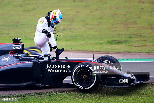 Fernando Alonso of Spain and McLaren Honda gets out of his car after he stopped on track during practice for the Formula One Grand Prix of Brazil at...