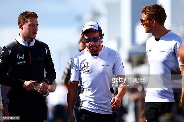 Fernando Alonso of Spain and McLaren Honda Jenson Button of Great Britain and McLaren Honda and Stoffel Vandoorne of Belgium and McLaren Honda walk...