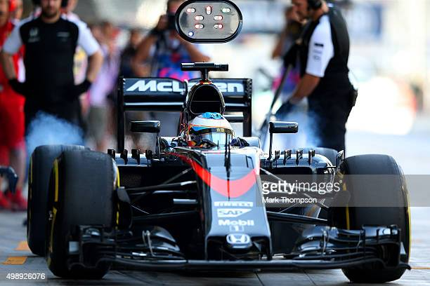 Fernando Alonso of Spain and McLaren Honda leaves the pit lane after a tyre change during practice for the Abu Dhabi Formula One Grand Prix at Yas...
