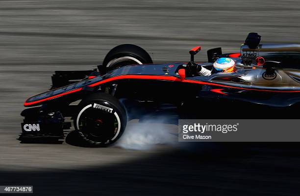 Fernando Alonso of Spain and McLaren Honda locks up during practice for the Malaysia Formula One Grand Prix at Sepang Circuit on March 27 2015 in...
