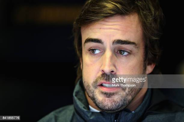 Fernando Alonso of Spain and McLaren Honda looks on in the garage during qualifying for the Formula One Grand Prix of Italy at Autodromo di Monza on...