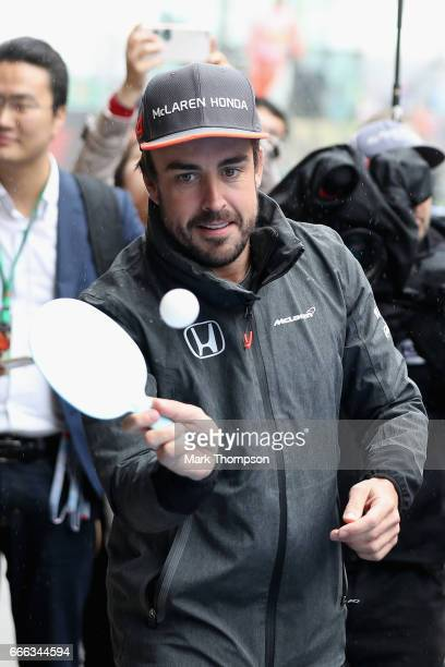 Fernando Alonso of Spain and McLaren Honda plays ping pong before the drivers parade during the Formula One Grand Prix of China at Shanghai...