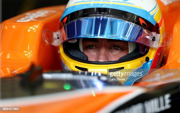 Fernando Alonso of Spain and McLaren Honda prepares to drive in the garage during practice for the Bahrain Formula One Grand Prix at Bahrain...