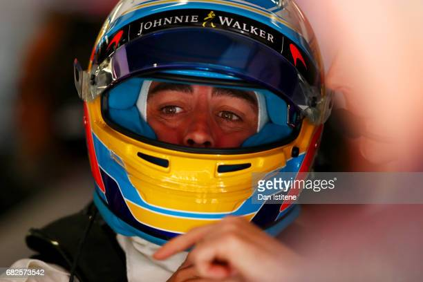 Fernando Alonso of Spain and McLaren Honda prepares to drive in the garage during final practice for the Spanish Formula One Grand Prix at Circuit de...