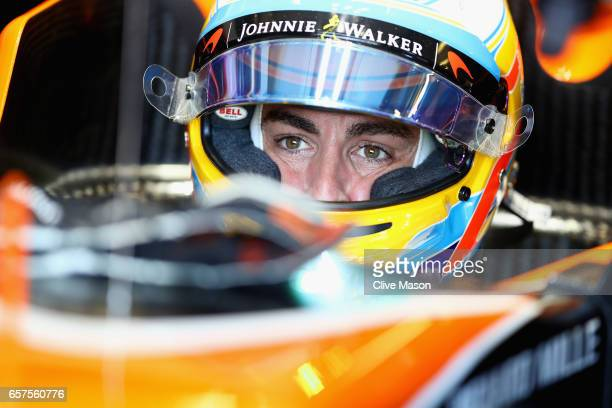 Fernando Alonso of Spain and McLaren Honda sits in his car in the garage during final practice for the Australian Formula One Grand Prix at Albert...