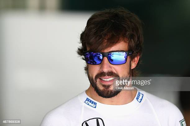 Fernando Alonso of Spain and McLaren Honda smiles in the garage during final practice for the Malaysia Formula One Grand Prix at Sepang Circuit on...