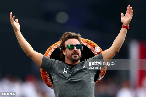 Fernando Alonso of Spain and McLaren Honda soaks up the atmosphere on the drivers parade before the Formula One Grand Prix of Mexico at Autodromo...