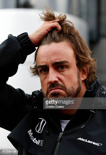 Fernando Alonso of Spain and McLaren Honda speaks with members of the media in the paddock during previews to the Formula One Grand Prix of Austria...