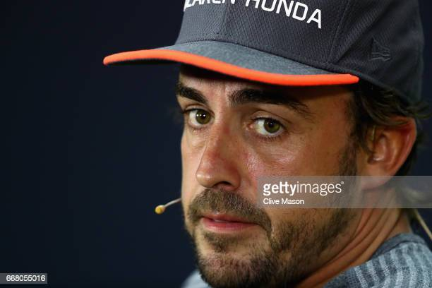 Fernando Alonso of Spain and McLaren Honda talks in the Drivers Press Conference during previews to the Bahrain Formula One Grand Prix at Bahrain...