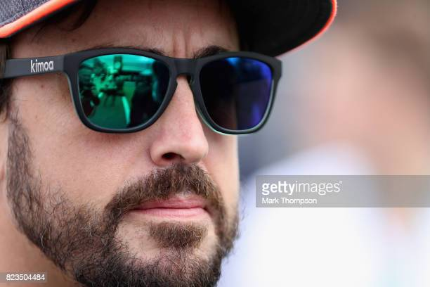 Fernando Alonso of Spain and McLaren Honda talks in the Paddock during previews ahead of the Formula One Grand Prix of Hungary at Hungaroring on July...