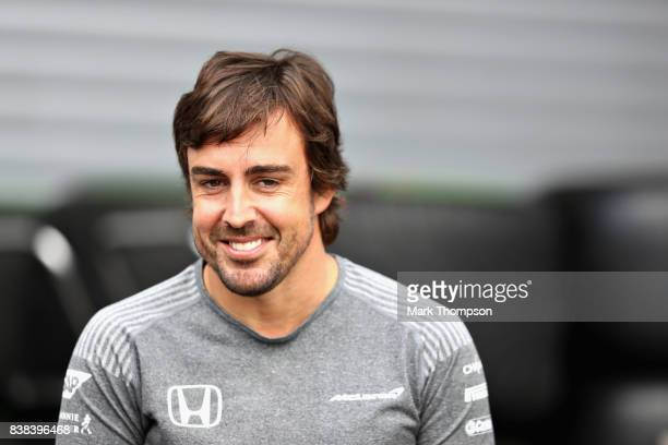 Fernando Alonso of Spain and McLaren Honda talks in the Paddock during previews ahead of the Formula One Grand Prix of Belgium at Circuit de...