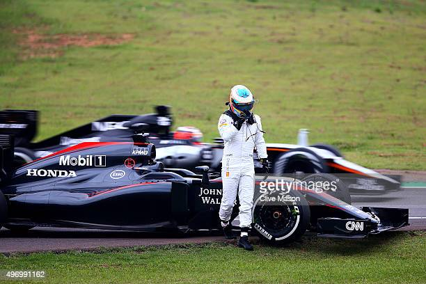 Fernando Alonso of Spain and McLaren Honda walks away from his car after he stopped on track during practice for the Formula One Grand Prix of Brazil...