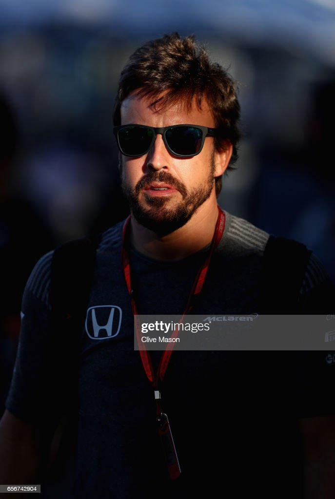 Fernando Alonso of Spain and McLaren Honda walks in the Paddock during previews to the Australian Formula One Grand Prix at Albert Park on March 23, 2017 in Melbourne, Australia.