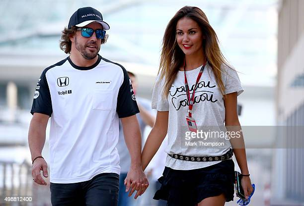Fernando Alonso of Spain and McLaren Honda walks in the paddock with his girlfriend Lara Alvarez during previews for the Abu Dhabi Formula One Grand...